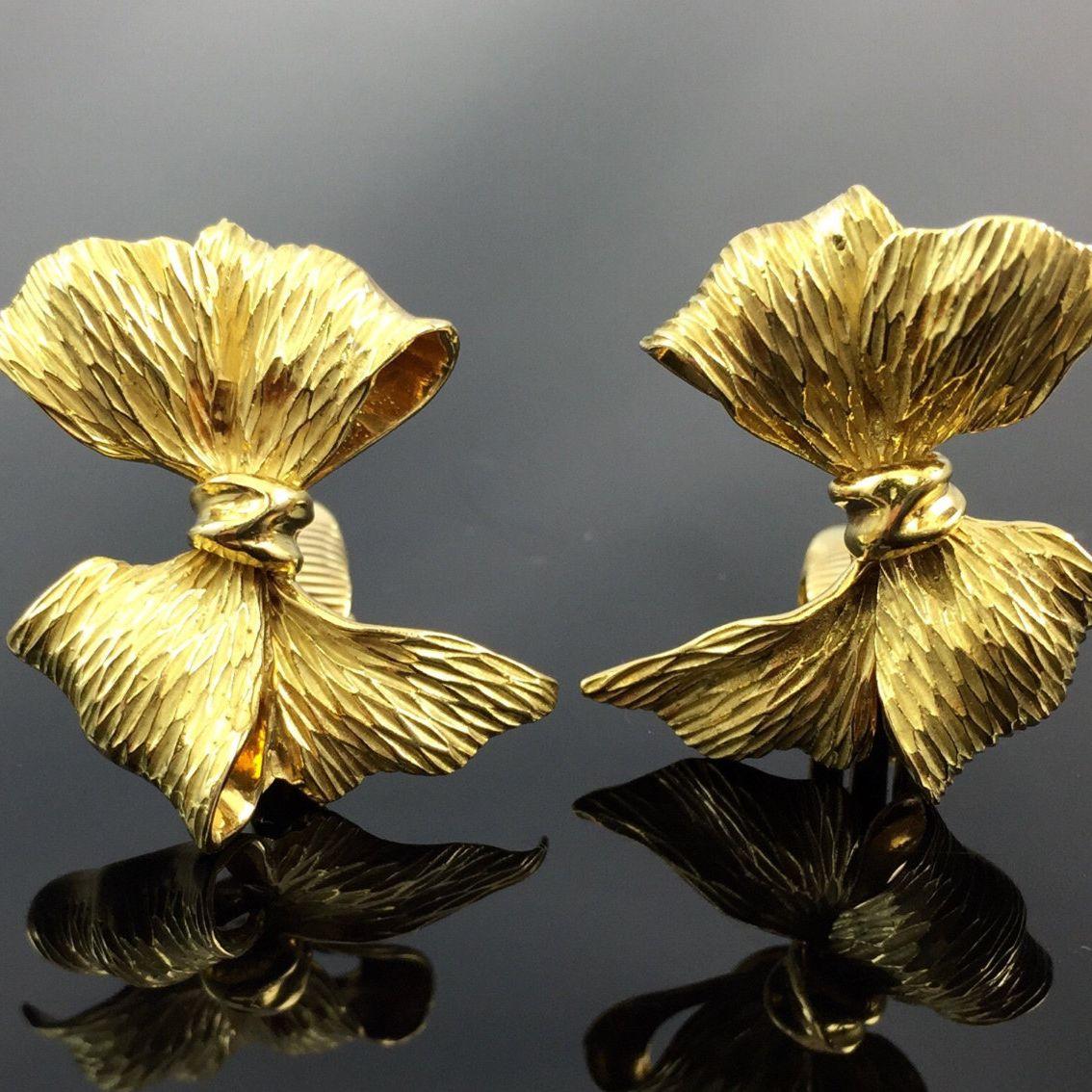 metal bows circa 1980s Vintage Red Earrings